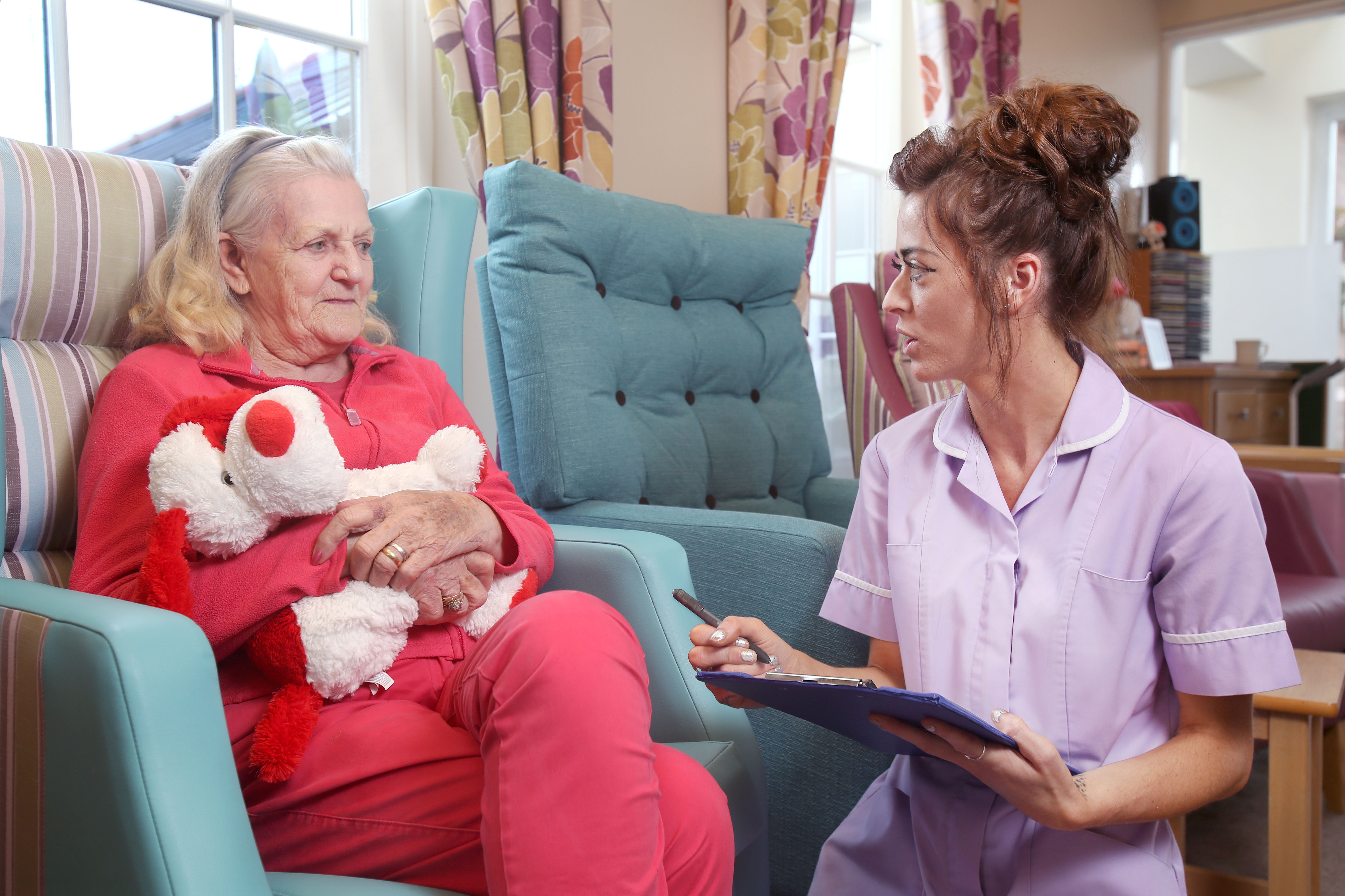 care assistant checking menu choices with resident