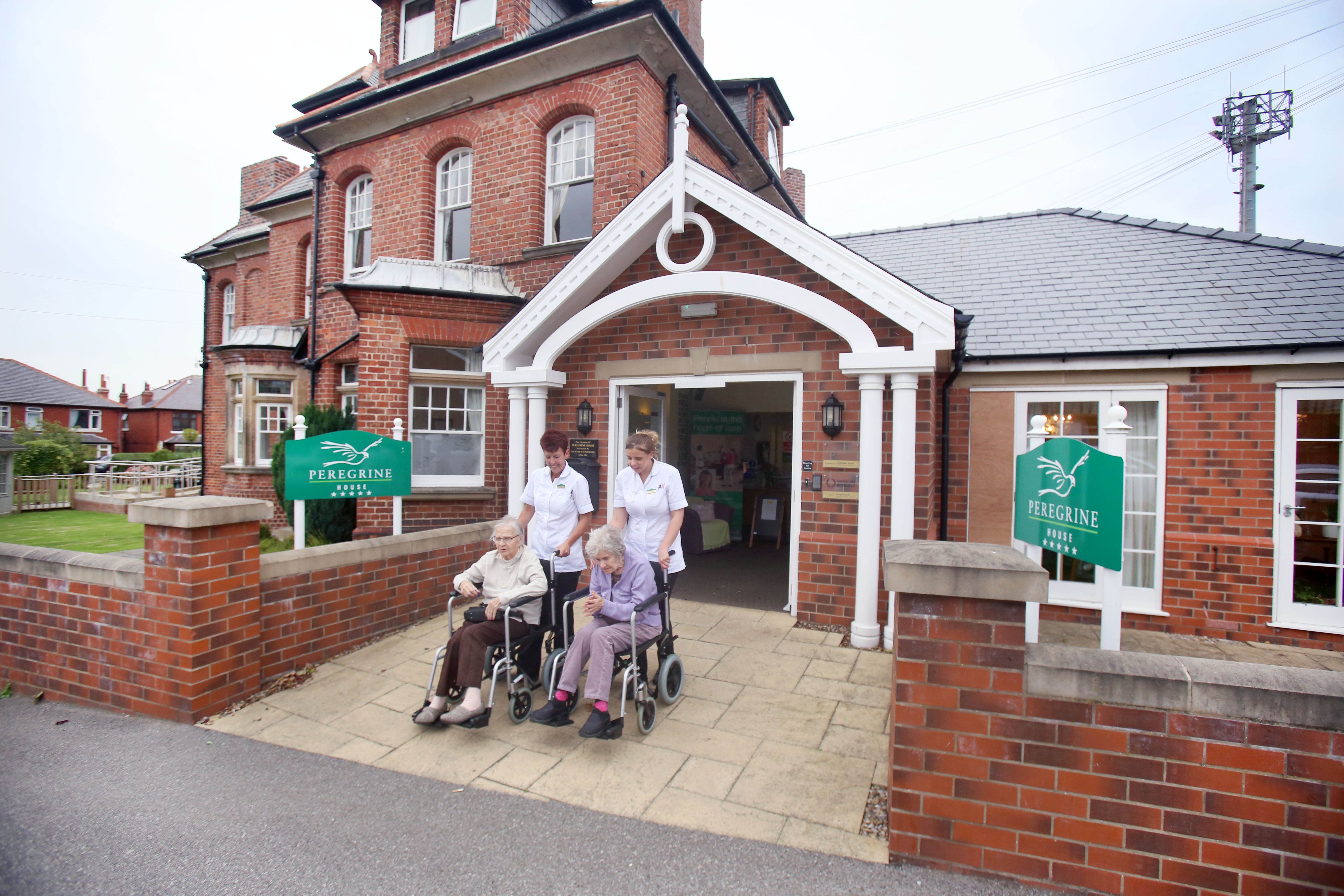 Residents going for an outing with carers