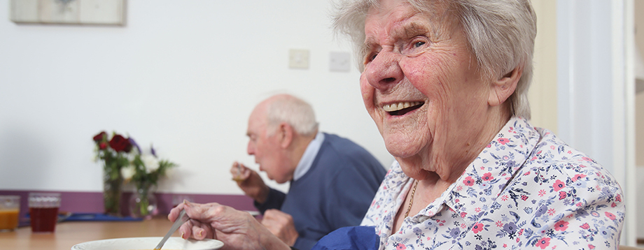 residents enjoying a meal at Peregrine House