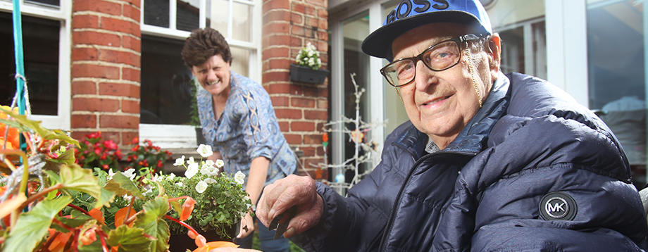 A resident enjoying accessible gardening from his wheelchair