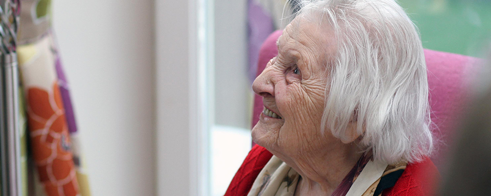 A happy resident at the extension opening party