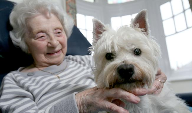A resident with visiting pet dog, Lulu