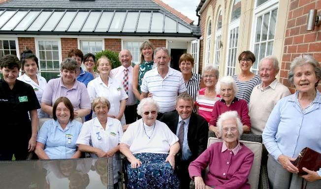 Staff and residents celebrate the Quality in Care Award