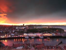 sunset over whitby harbour